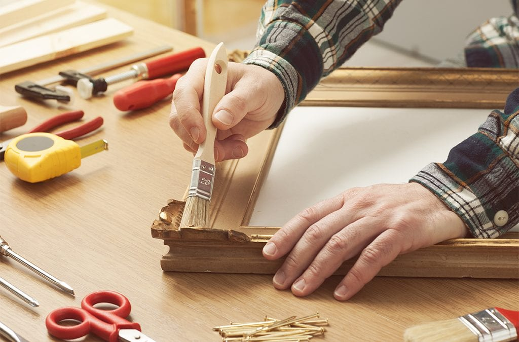 man building a picture frame