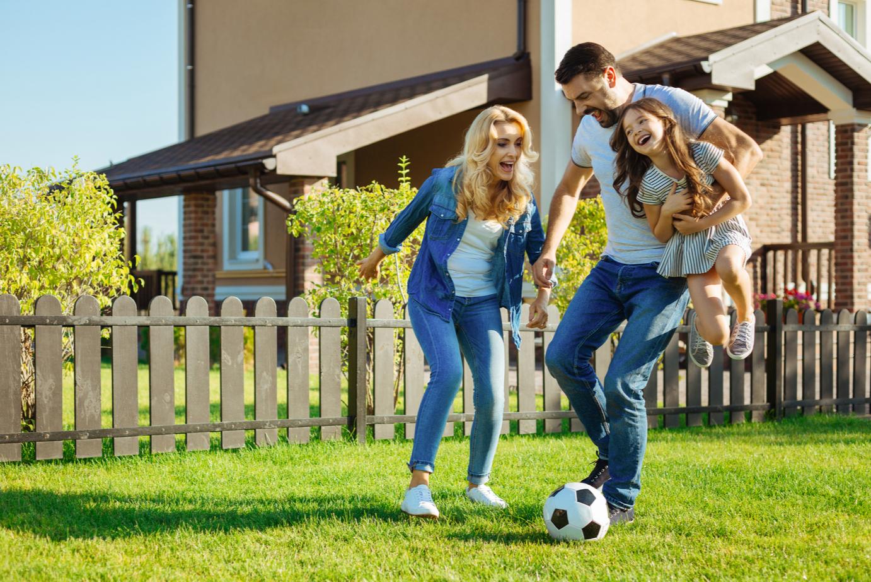 family on fresh green lawn