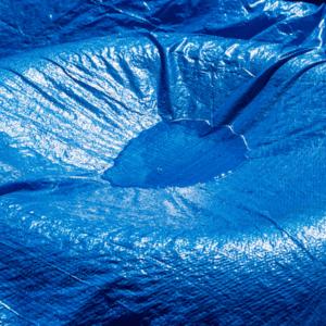blue tarp holding water