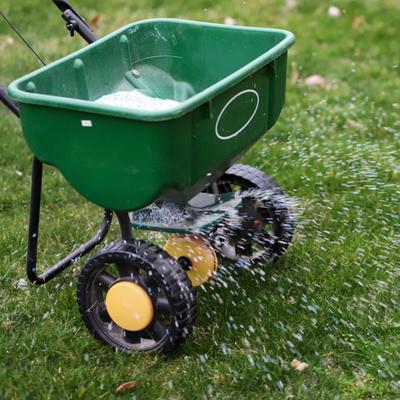 fertilizer being spread by a spreader